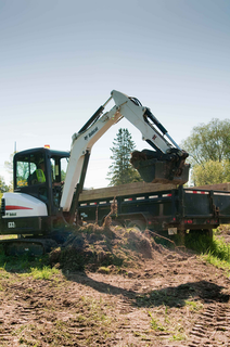 The new Tier 4-compliant E32i (pictured) and E35i feature have about 8 percent more fuel efficiency and a new forward-mount instrumentation system.