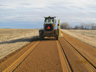 After injection of 38-percent liquid calcium chloride, the road base was compacted and then bladed to a 2.5-percent crown.