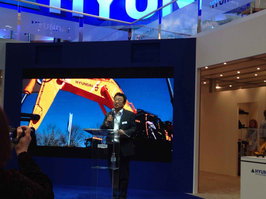 Hyundai President S.M. Yoon tells press attendees at ConExpo-Con/Agg about the company's upcoming Tier 4 Final models.