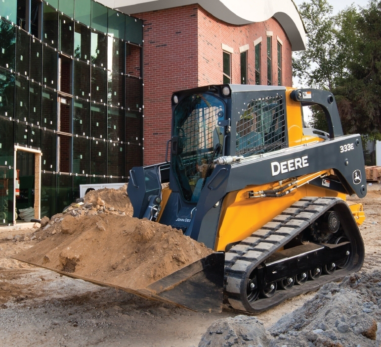 The E-Series compact track loaders offer 25 percent more foot room than previous models. Low-effort electric-hydraulic controls on the 333E are available for ISO, H and foot control patterns; an option allows you to switch between all three control patterns. Powered by a 3.3-liter diesel, the large-frame model has up to 10 percent more horsepower than the previous D-Series models.