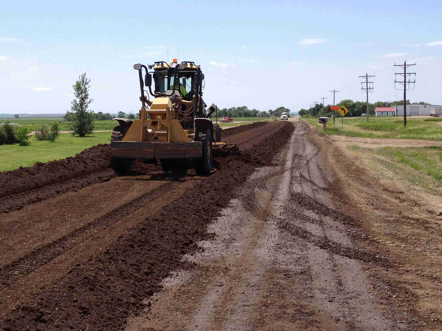 Workers applied three inches of aggregate to the road surface in the early stages of the Kosciusko County road base stabilization project.