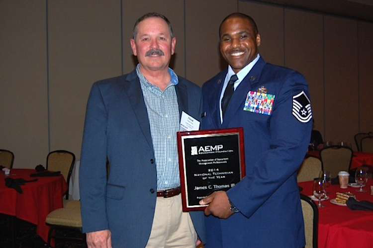 Thad Pirtle, of Traylor Brothers and the 2015 chairman of AEMP, with the 2014 Technician of the Year, Air Force Master Sgt. James C. Thomas III. Early in his career, Pirtle was the second recipient of the Technician of the Year award.