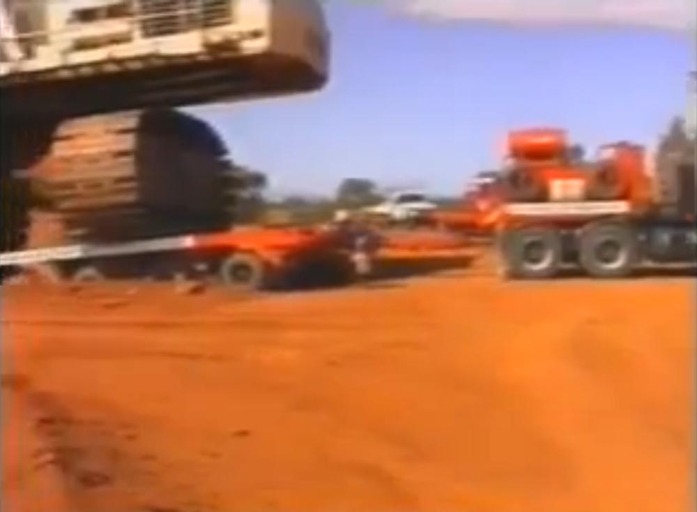 Dozer towing truck towing excavator
