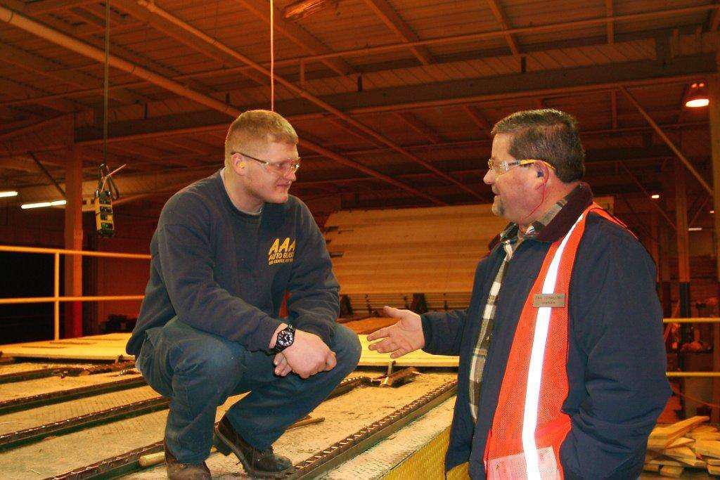 Jobsite chaplain Dan Schallmo, of Marketplace Chaplains, speaks with a construction worker.