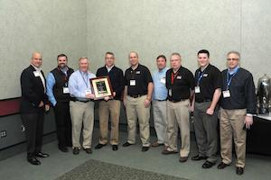 Representatives from Hale Trailer Brake & Wheel accept Talbert Manufacturing's 2013 Top Dealer award.