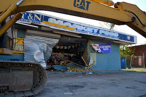 A stolen Cat 320 excavator in front of the market in Cleveland thieves used to break in.