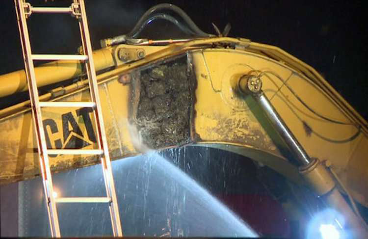 Houston police found 60 bricks of marijuana inside the excavator. Credit: KHOU TV