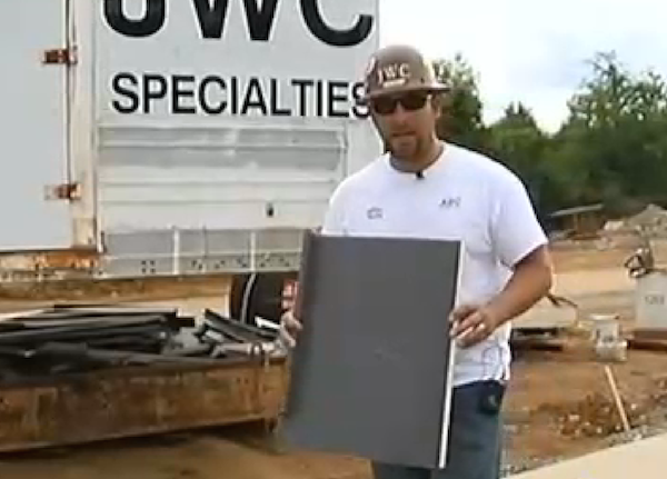 Project superintendent Jared Johnson with a sample of the roofing he helped recover. Credit: WSMV TV