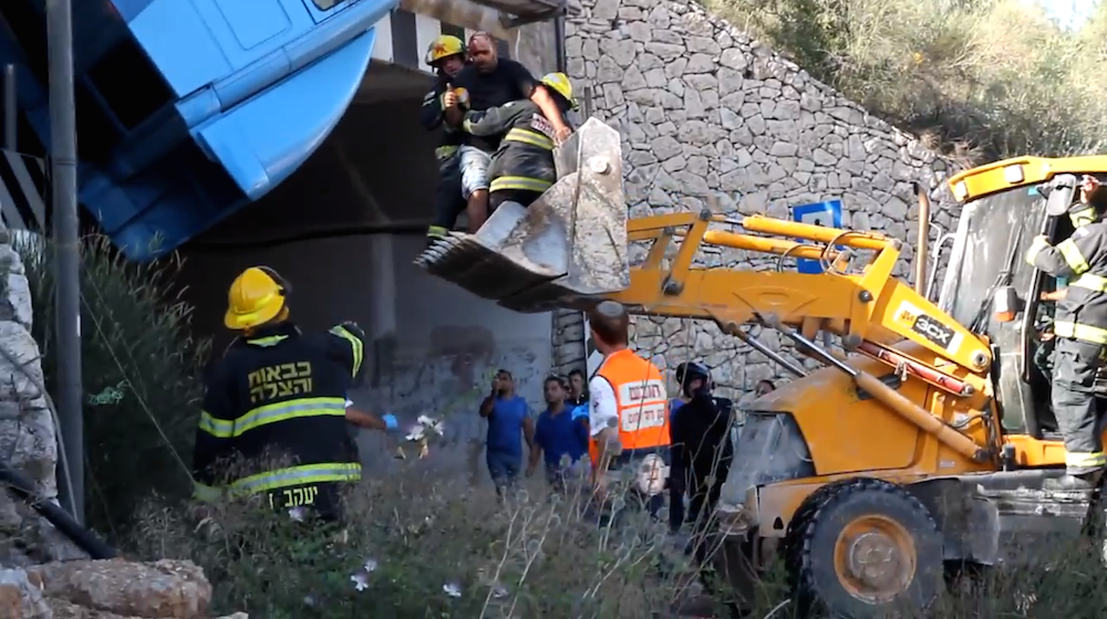 backhoe rescue of truck driver over tunnel Israel