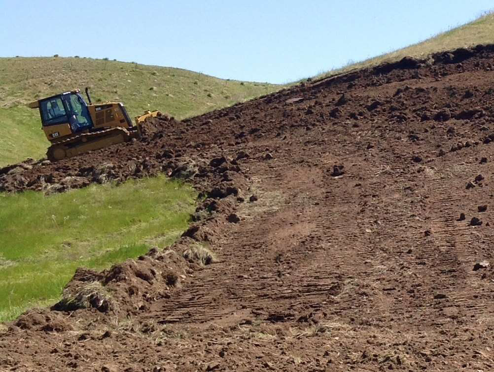 A Cat dozer can be seen perfecting a turn in a new TORC course being built in Sturgis, South Dakota.