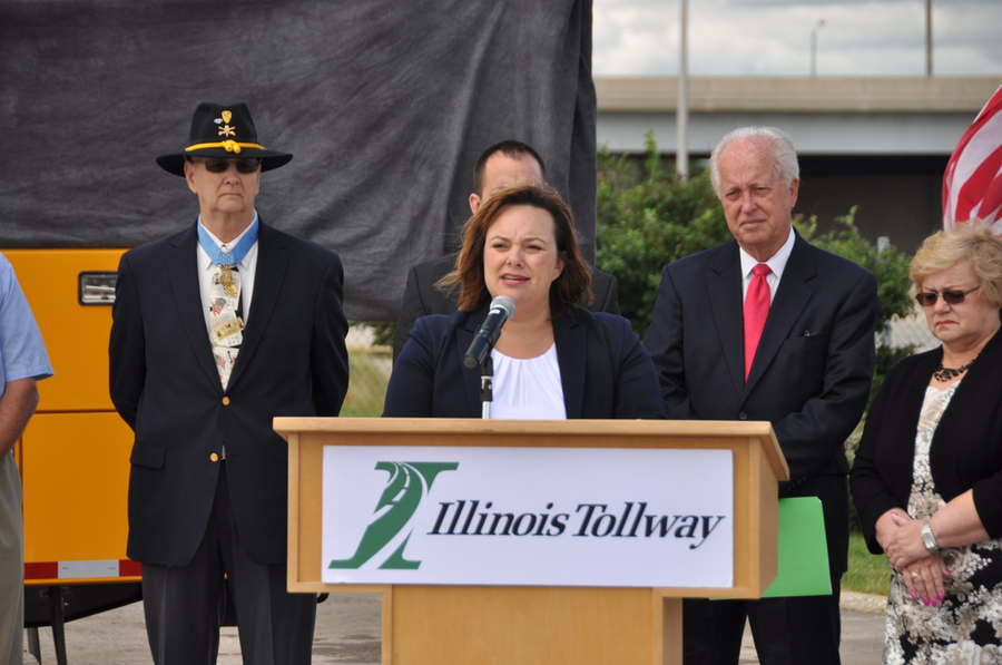 Illinois Tollway Executive Director Kristi Lafleur speaks during the ceremony. Behind her, from left to right, are Allen J. Lynch, State Sen. Terry Link and former State Rep. JoAnn Osmond.