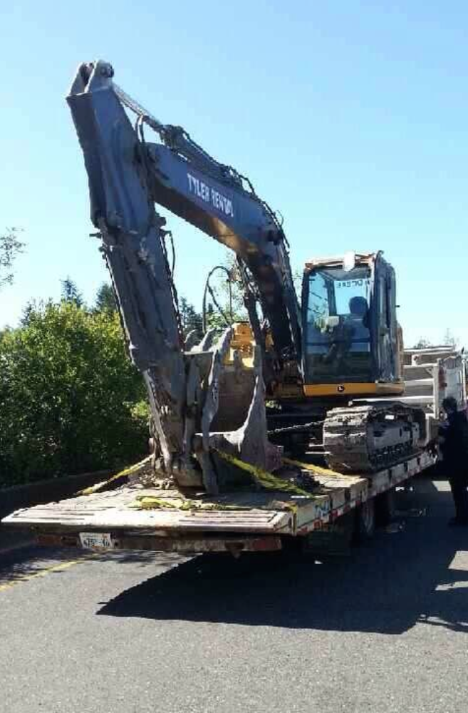 Driver hauling the excavator told troopers he was unaware he was hitting the bridges. Credit: Trooper Guy Gill/Twitter: @wspd1pio