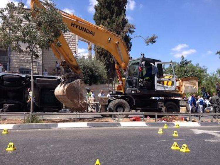 The crime scene in the aftermath of a terrorist attack in Jerusalem carried out with an excavator. Credit: Micky Rosenfeld/Twitter @MickyRosenfeld