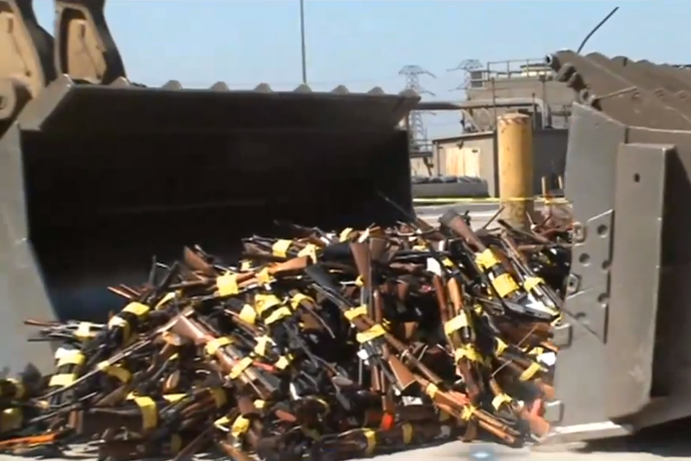 Wheel loaders scooped up nearly 5,000 guns to be melted down for road construction at the LA Sheriff's Department's annual Gun Melt.