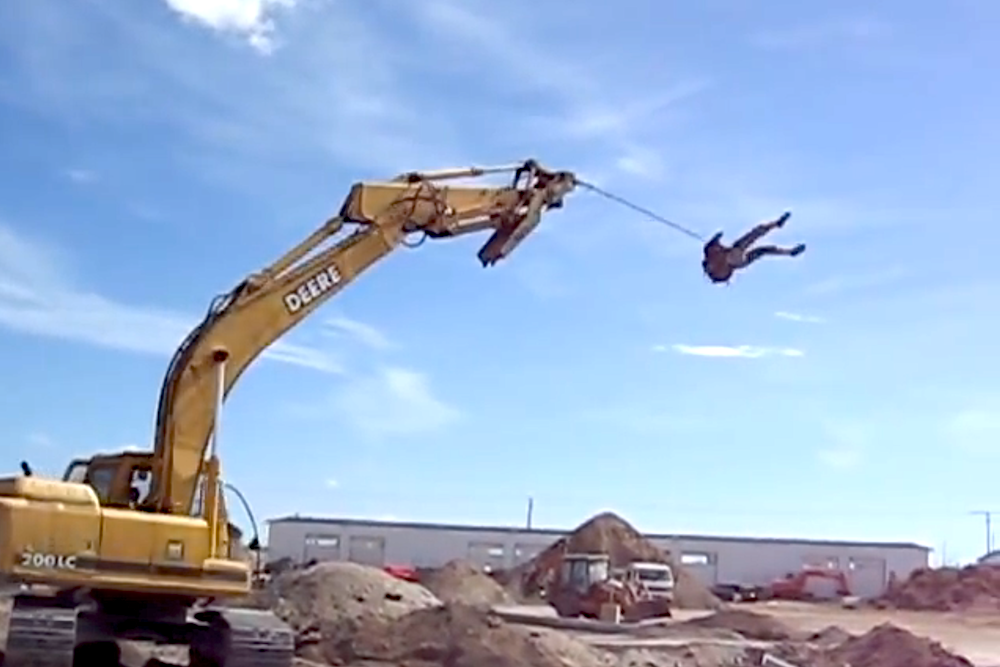 VIDEO: Geniuses wrap themselves in rope, let an excavator sling them