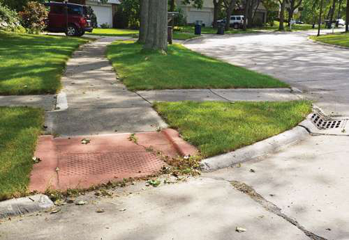 Older and newer: This older-style curb ramp contrasts with a late model in foreground
