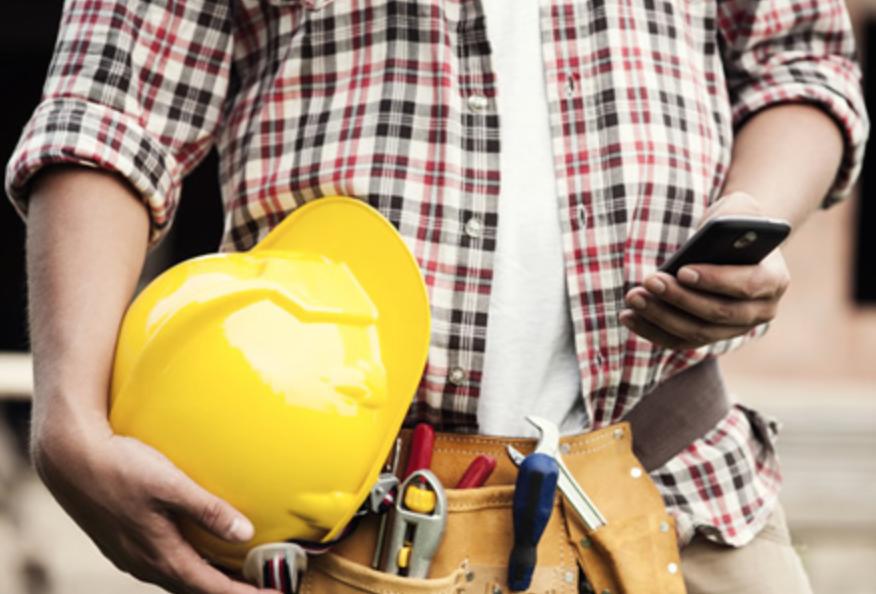 construction contractor worker using smartphone
