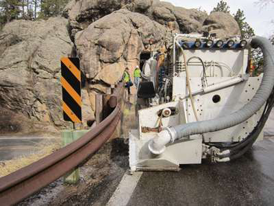 Working on the narrow Iron Mountain Road in South Dakota, two grinder operators were required to control the accuracy of the grinding process.