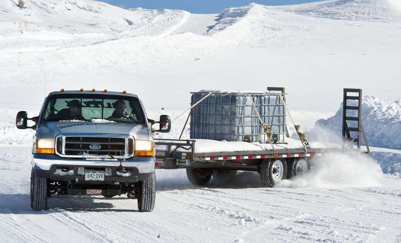 Accelerating the tow vehicle while keeping its wheels pointed straight is the best way to bring a sliding trailer under control according to winter driving experts. | Photo: Larry Walton/Editorial Services West