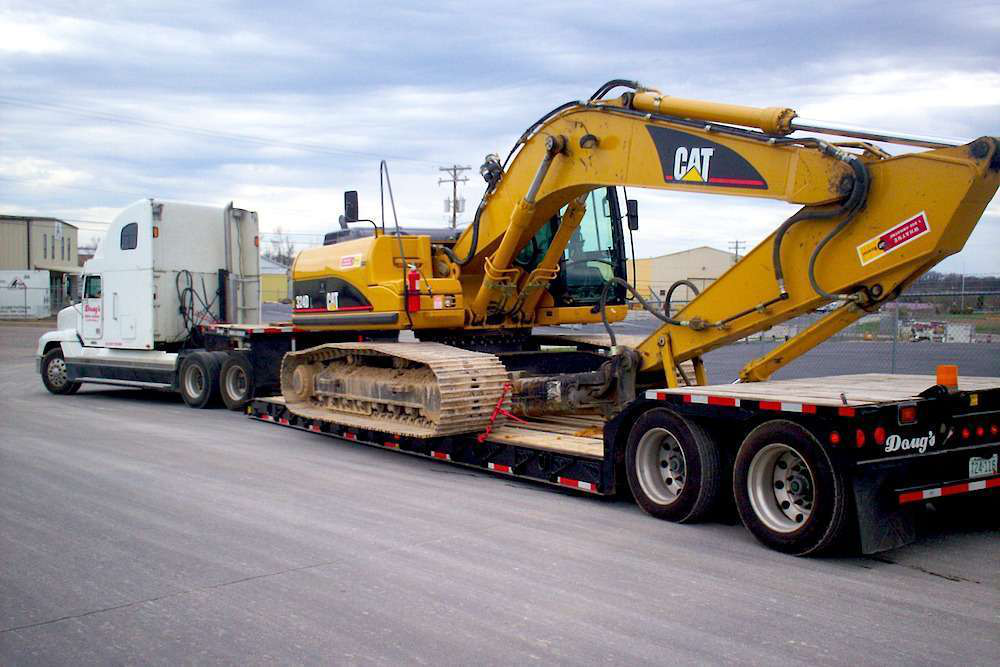 Heavy equipment hauling heavy haul construction equipment