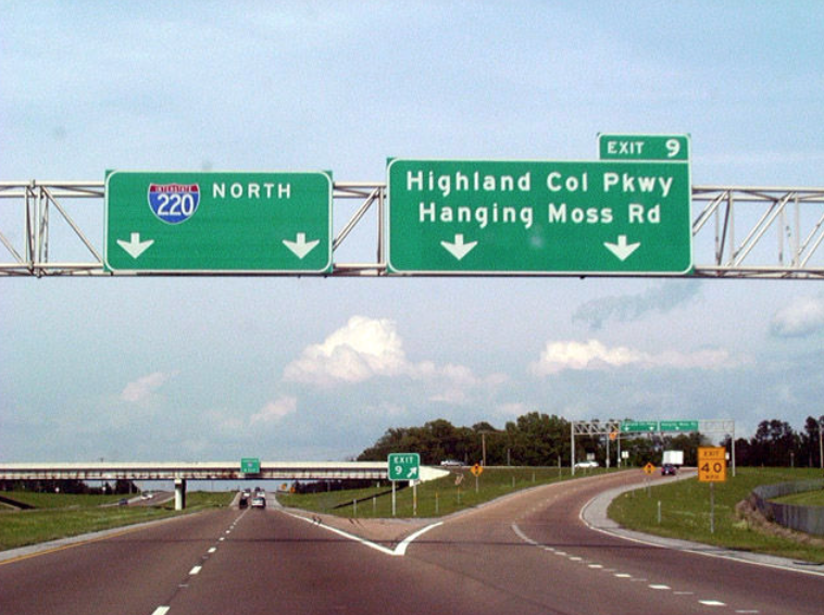 Road signs along Interstate 220
