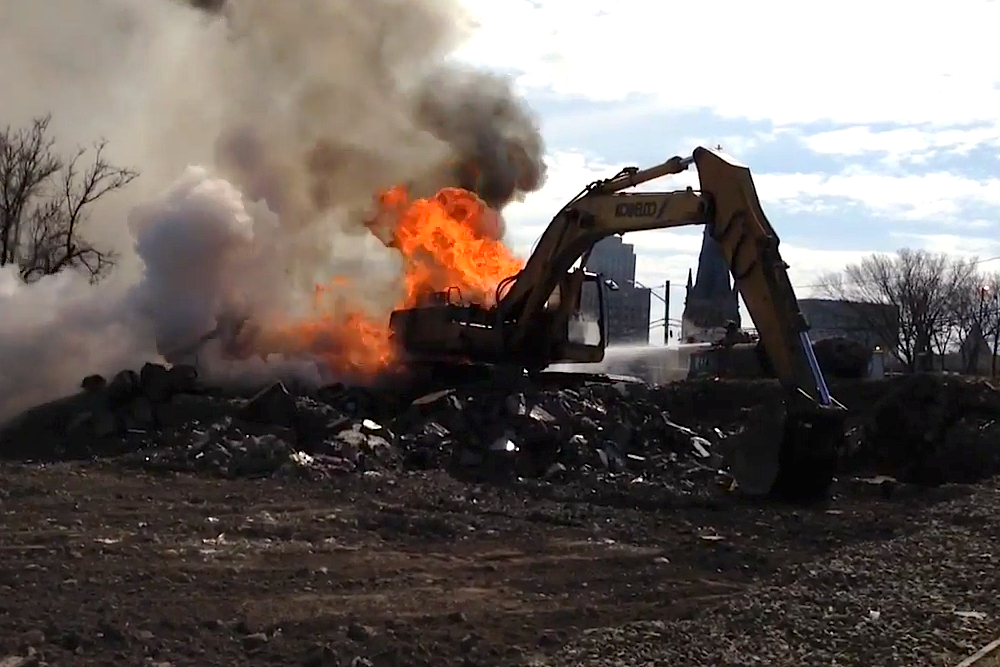 Excavator explodes into flames after engine malfunction on