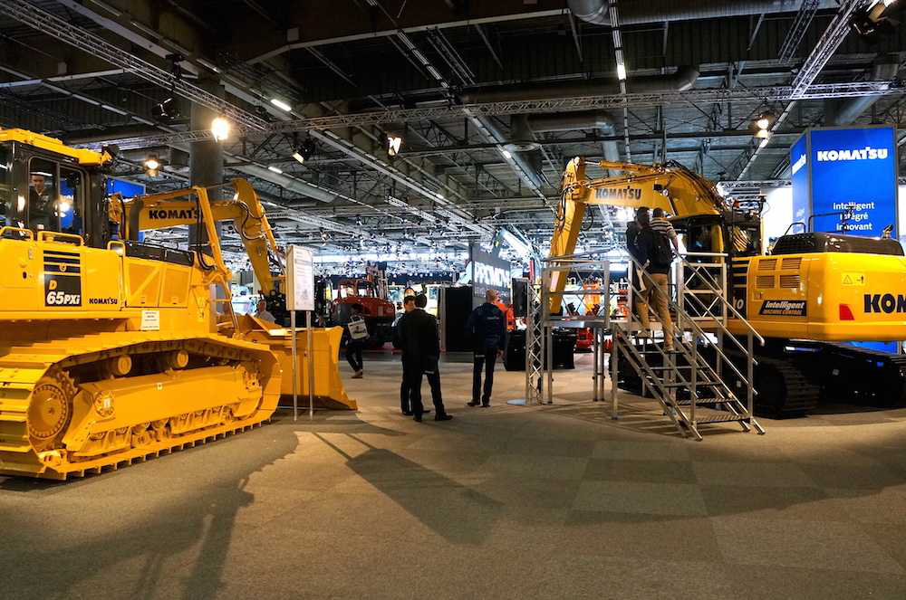 Komatsu's intelligent D65PXi-18 dozer and PC210LCi-10 excavator took center stage in the company's Intermat booth.