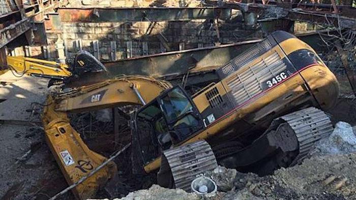 Excavator fall in Massachusetts bridge