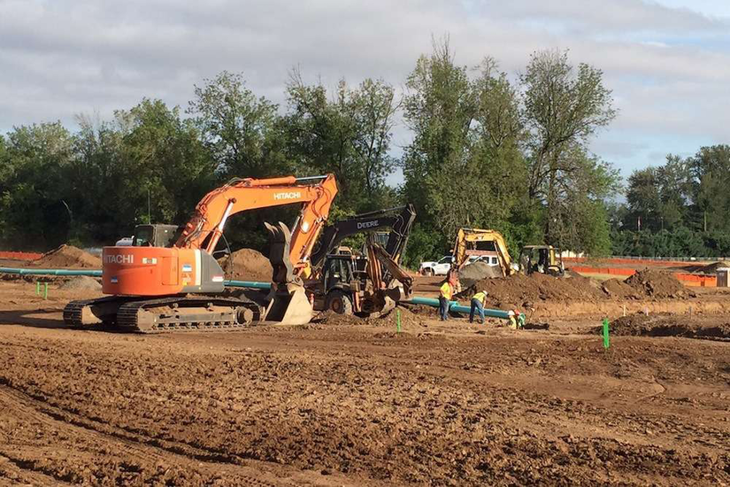 construction site prep with hitachi and deere equipment