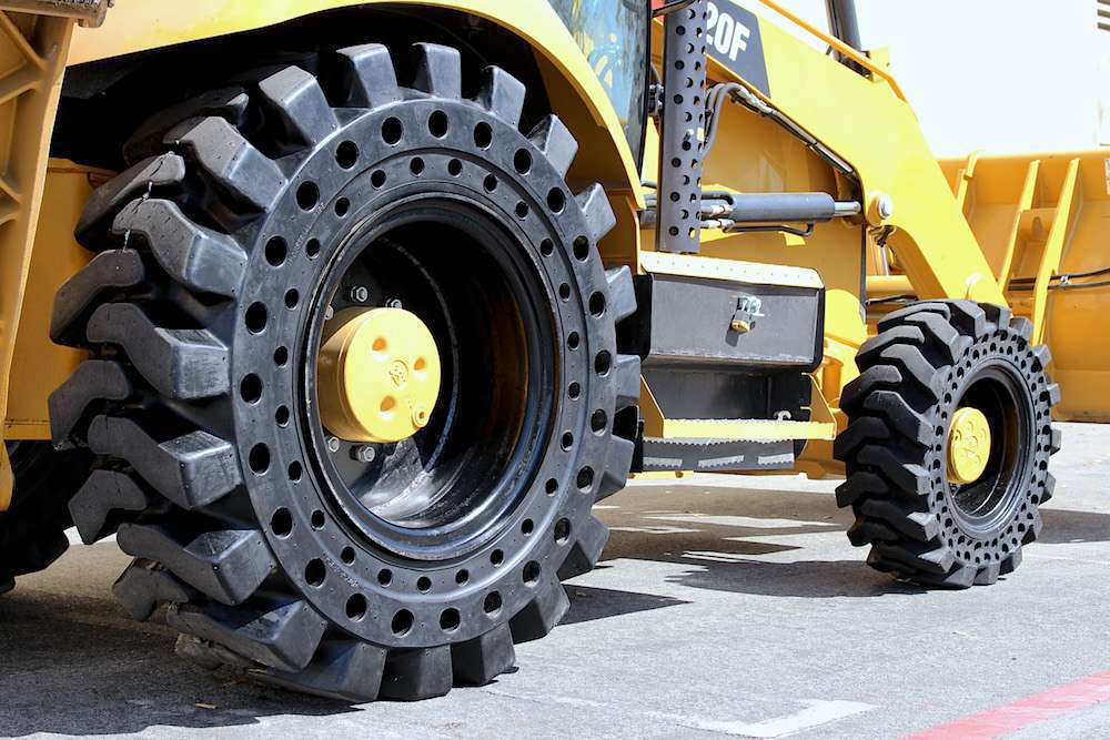 Mclaren Expands Flat Proof Nu Air Lineup To Rear Backhoe Tires