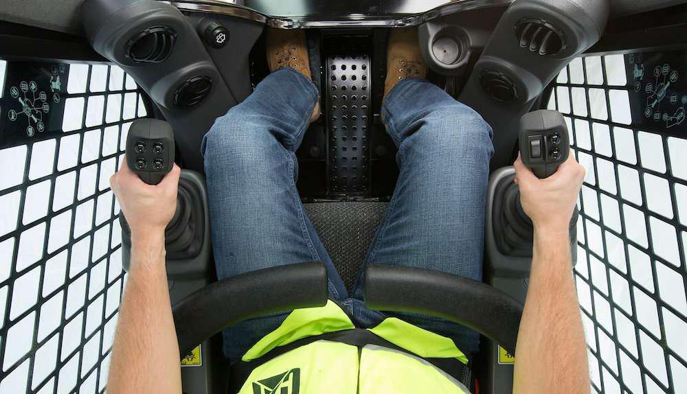 Skid Steer Control Levers : Caterpillar brings hand foot controls to d series skid