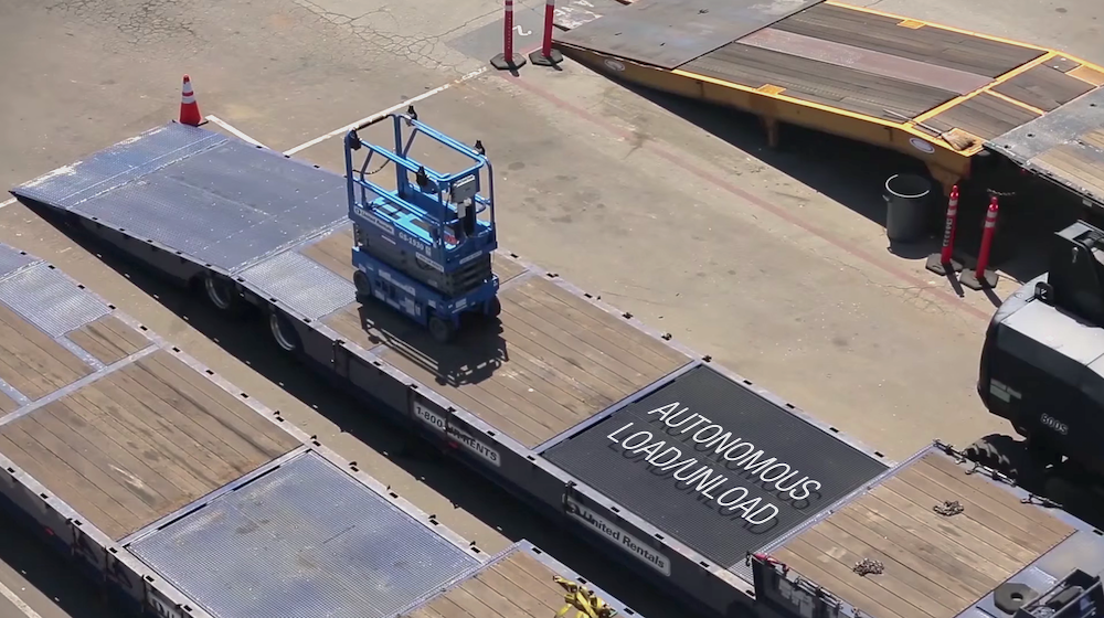 A scissor lift loads itself onto a truck at a United Rentals yard using autonomous technology developed by 5D Robotics.