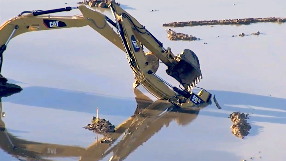 Excavator operator killed after machine becomes submerged for Pond equipment near me