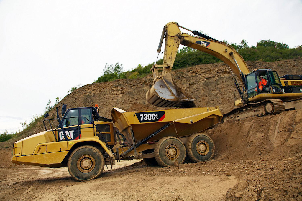 Cat's new 730C2 boasts a 17-percent productivity improvement over its Tier 3 predecessor thanks to a new engine, improved dump body and automatic traction control.