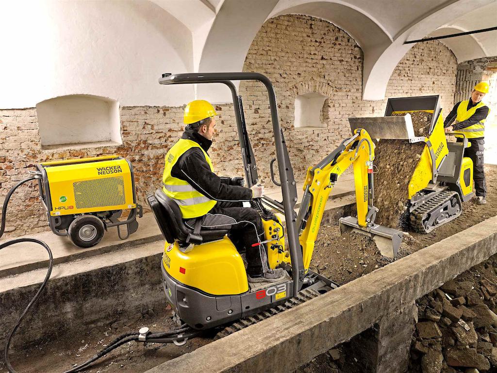 Wacker Neuson's dual-power 803 excavator and electric DT10e dumper working on an indoor demolition job.