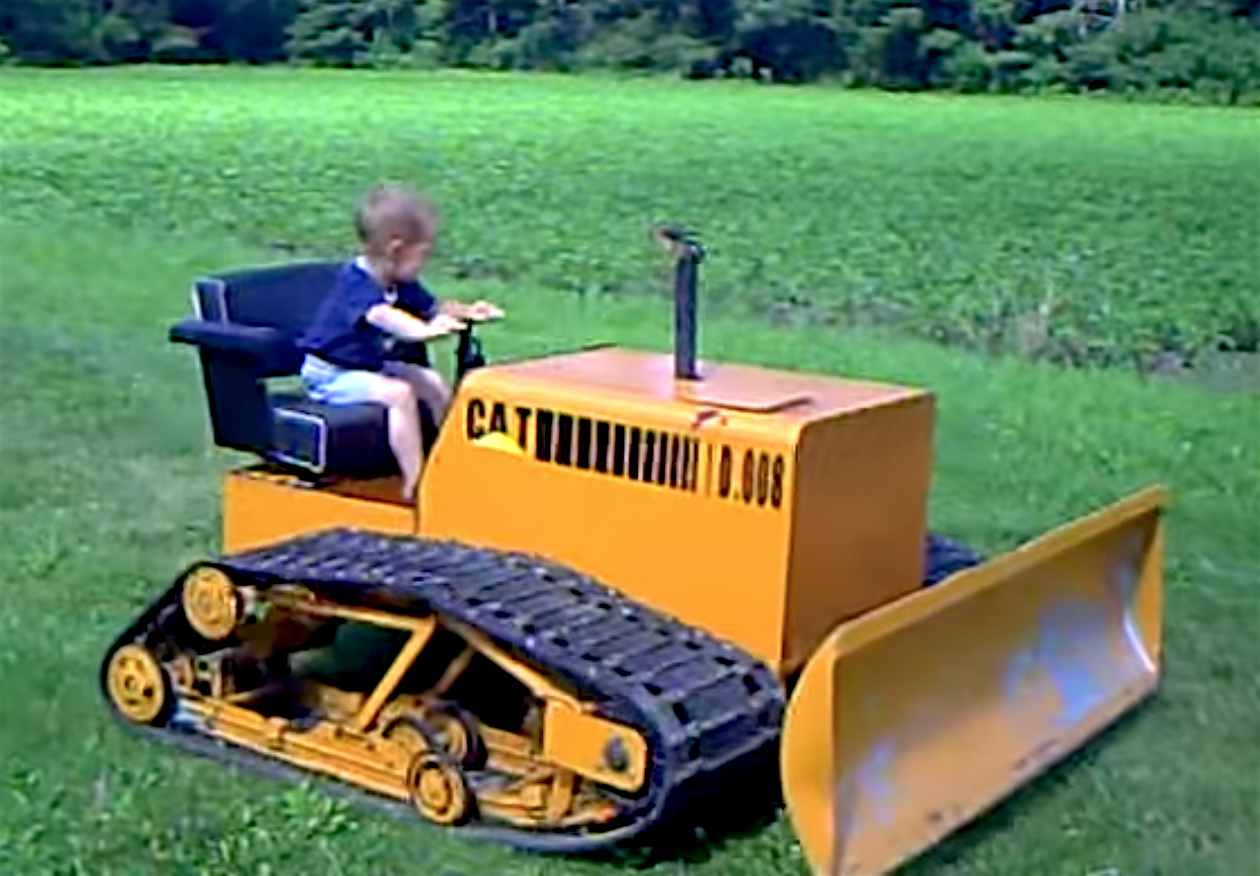 VIDEO: Toddler operates his Cat D8 homemade mini dozer like