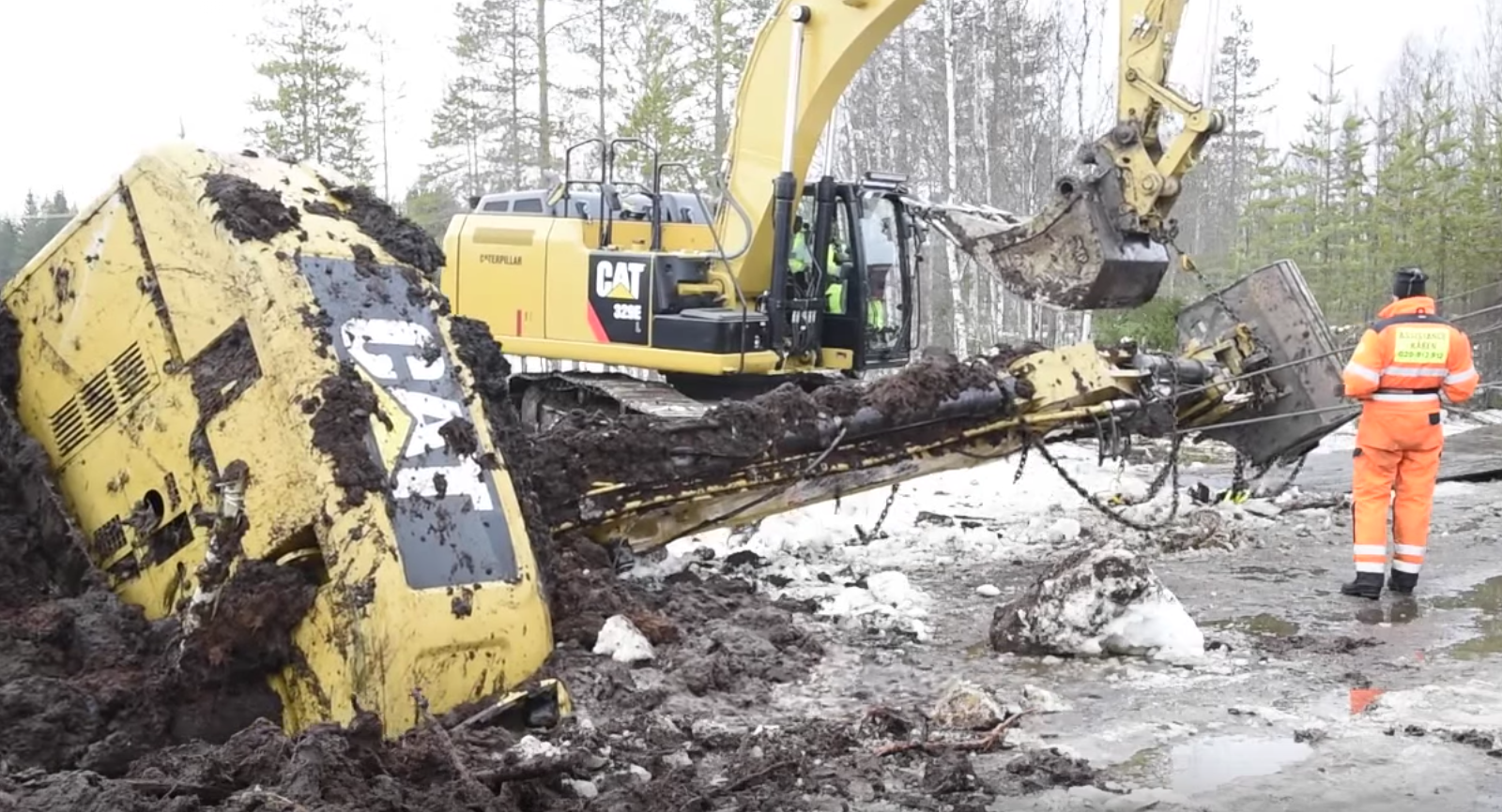VIDEO: Excavator salvaged from icy swamp in weeks-long operation
