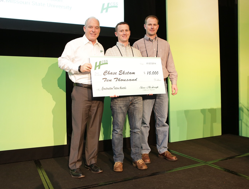 Last year's winner: Chase Ekstam (center) receiving his check from Steve McGough, HCSS president and COO (left). They are joined by Doug Fronick (right) of APAC-Central, who supervised Chase during his internship.