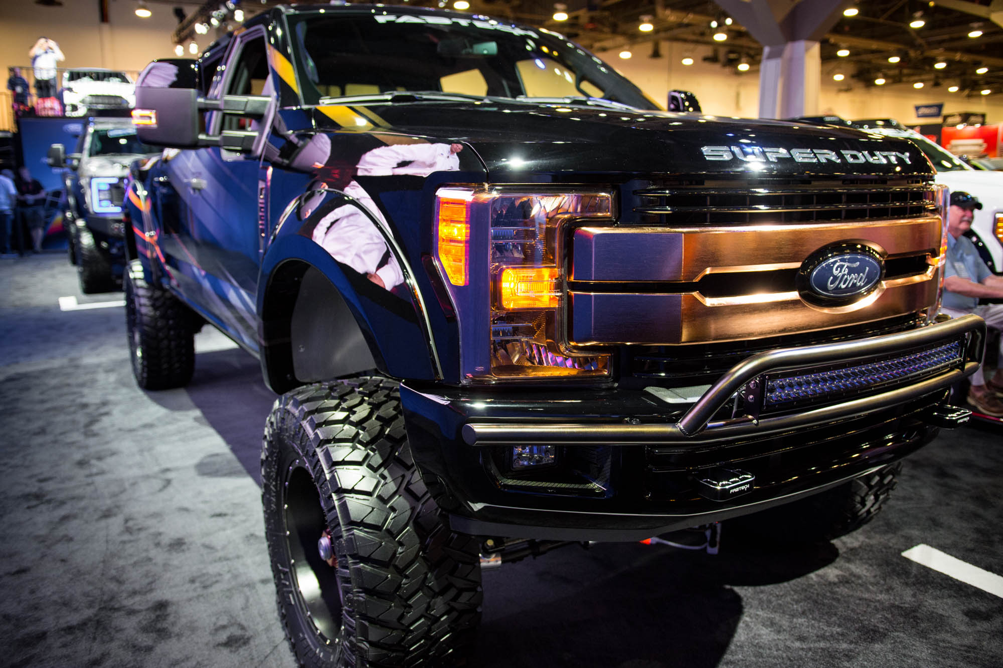 Shockzilla, an 8-in. lifted F-250 with exhaust stacks ...