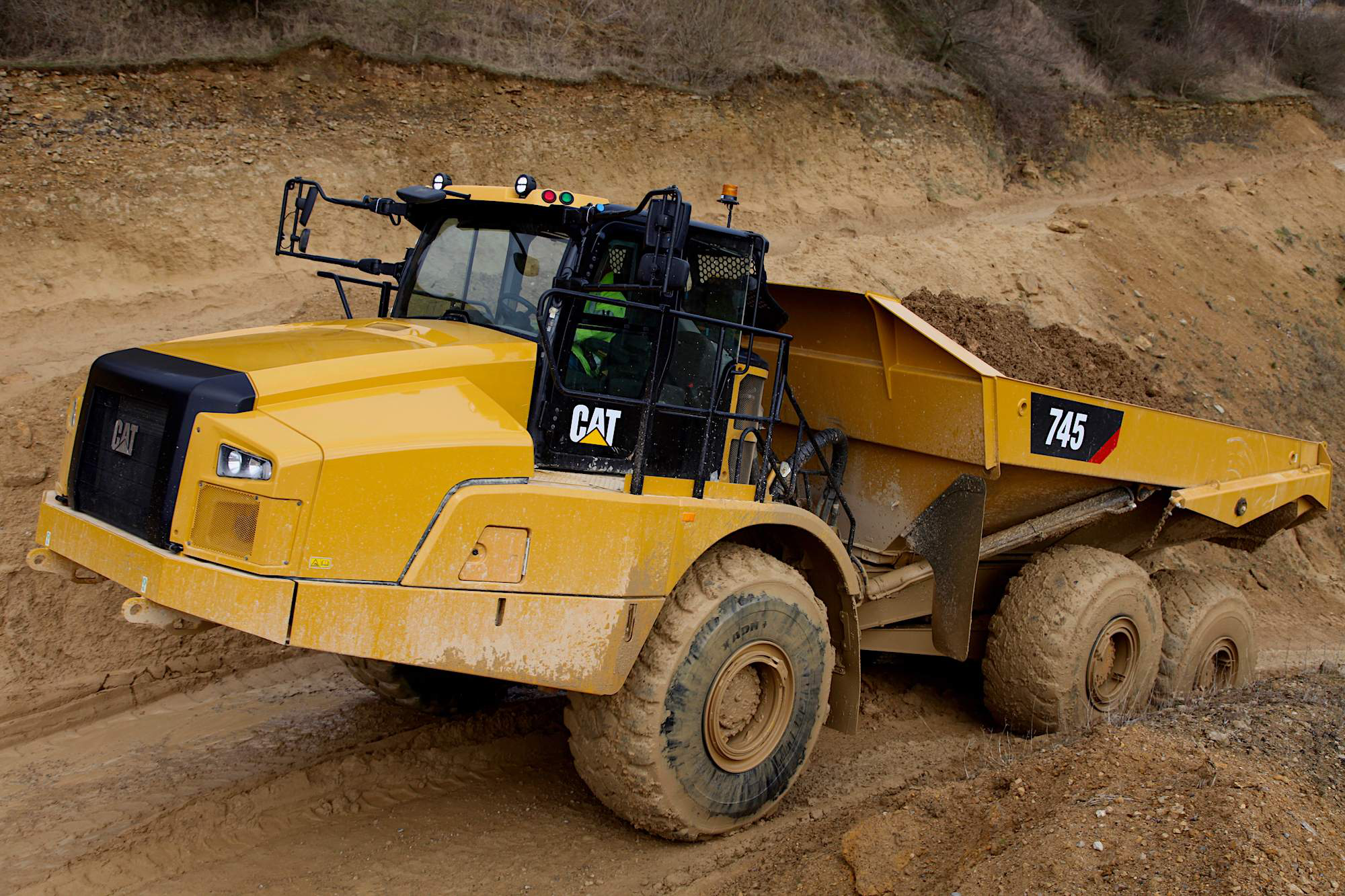 Cat unveils redesigned 745 articulated truck with larger cab, stability assist to counter overturns