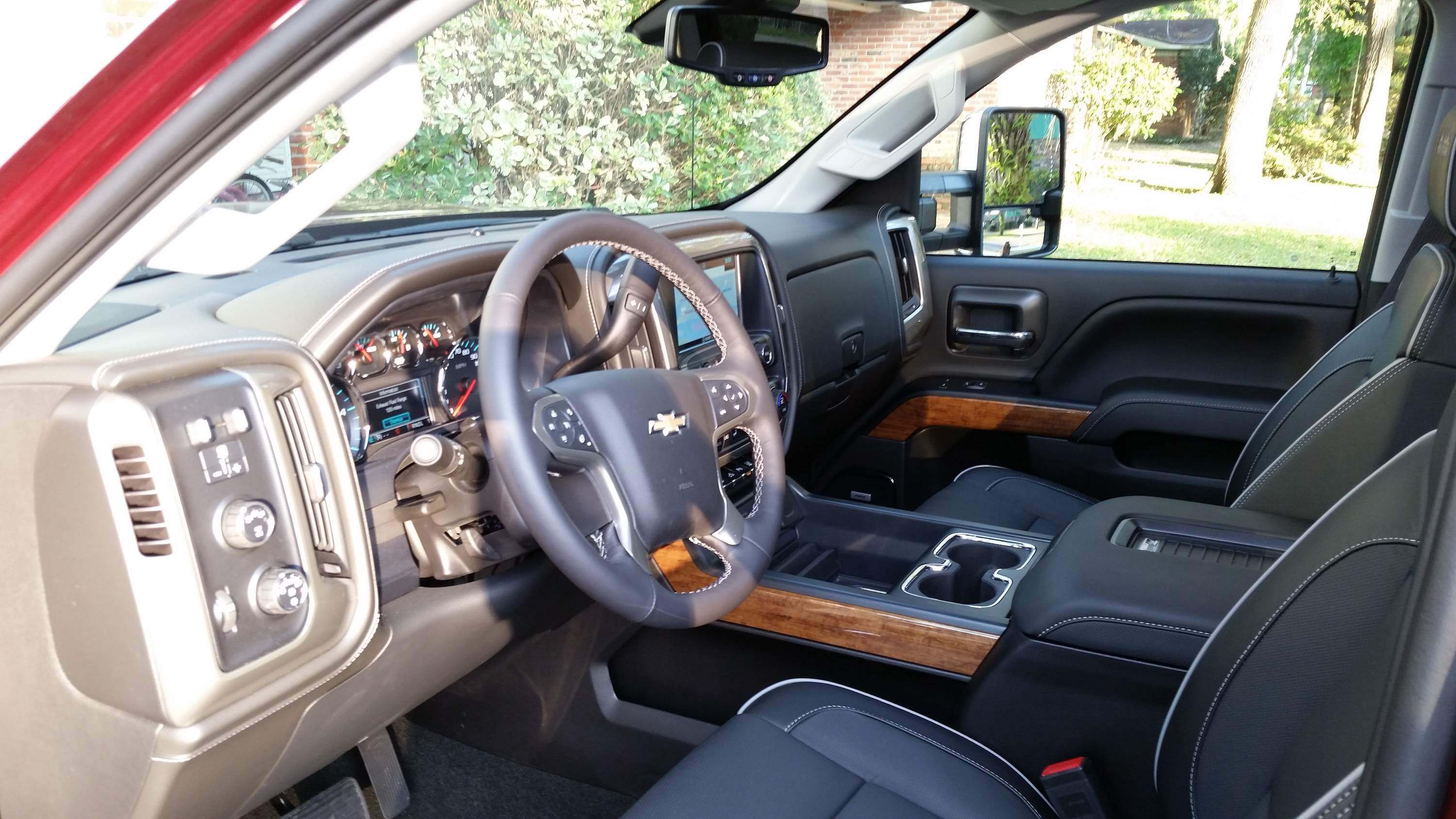 Comfort And Style Comes Together Nicely In The Interior Of The High Country  Silverado. Full Feature Leather Appointed Bucket Seats In The Front Of This  ...
