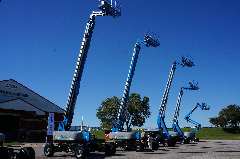 terex genie cranes in a line
