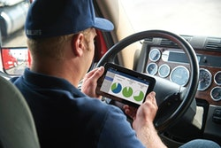 JJ Keller Driver_Adam w_tablet and log screen_D4S3106_clocks ELD