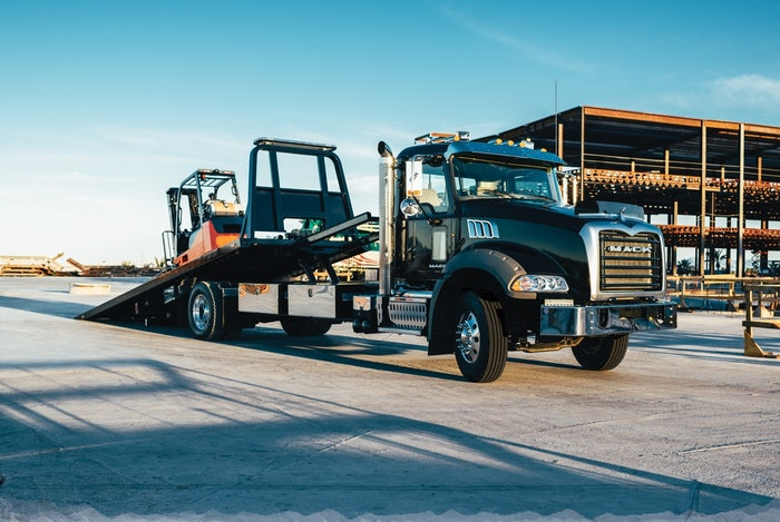 Mack Truck parked with forklift load
