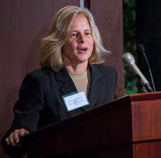 Marianne Watson speaking from a podium