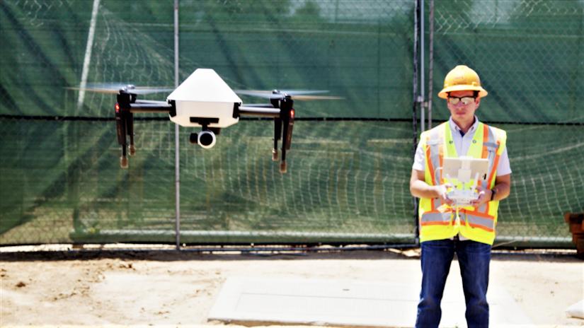 worker flying drone