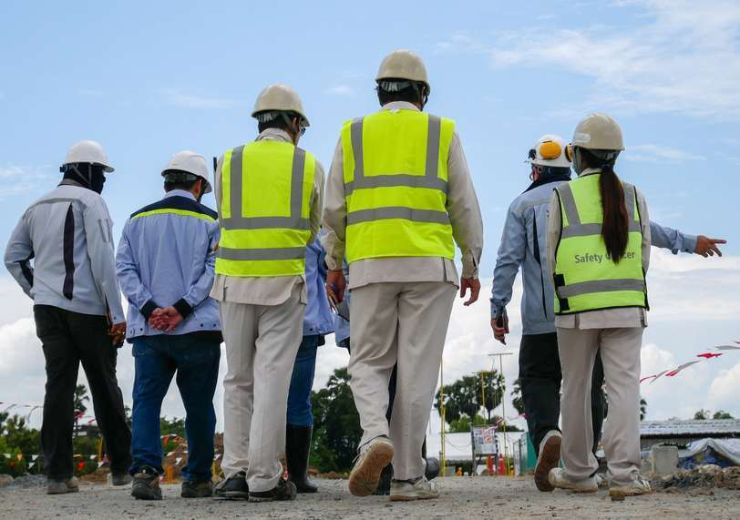 a group of construction safety workers