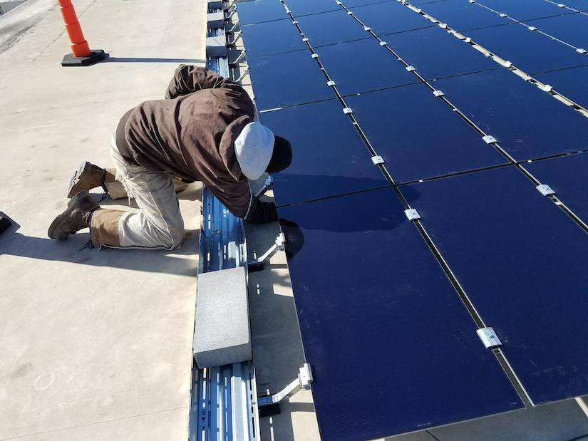 Foley Equipment installs solar panels with Cat Microgrid