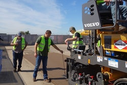 Volvo paving institute paver crew paving instruction training workers road institute