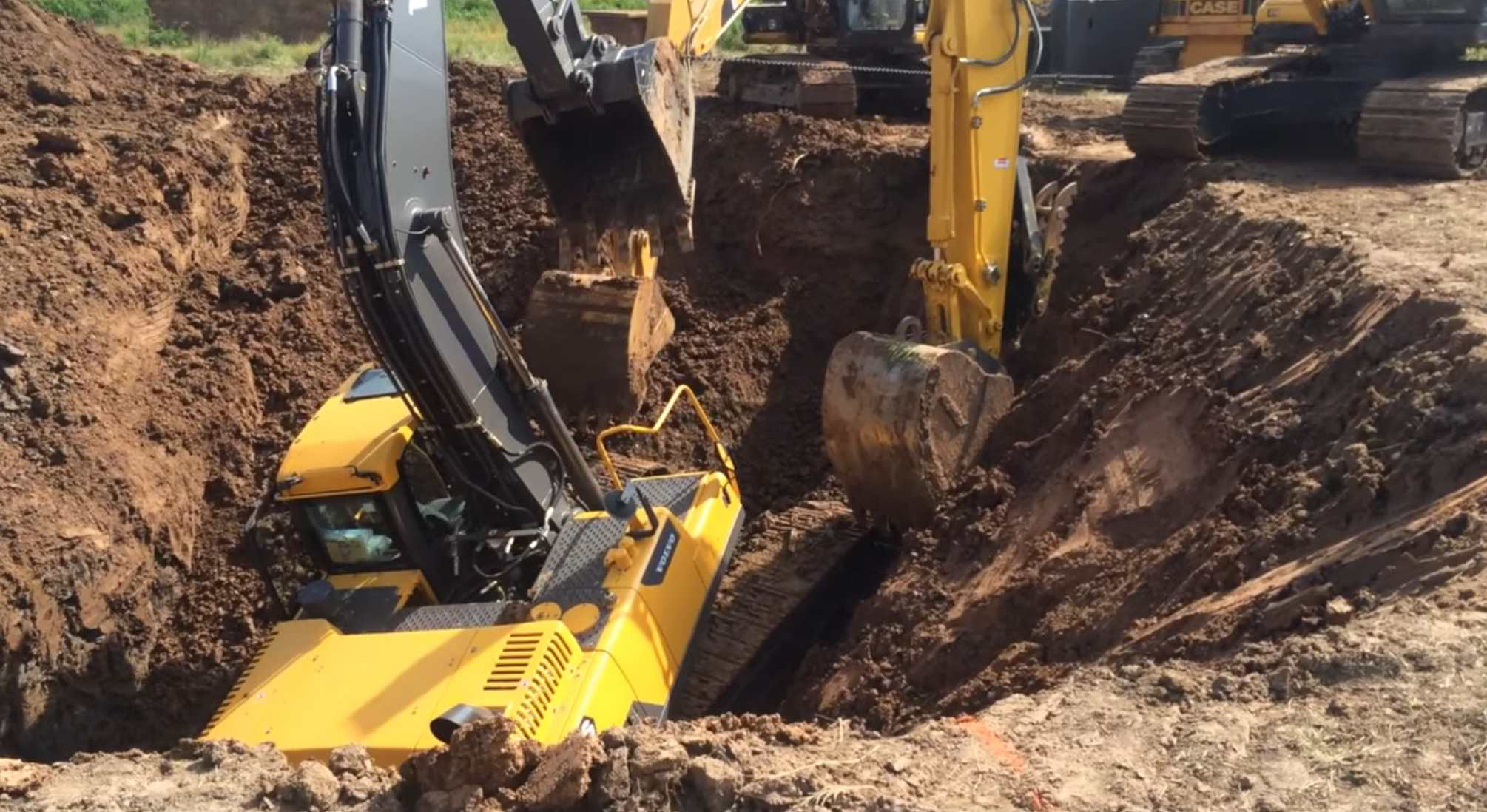 Watch Excavator Dig Its Way Out Of Hole